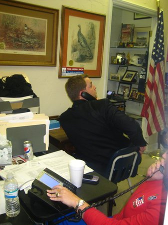Dustin Olson working the phones in the final hours of a winning campaign.